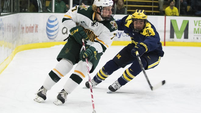 Catatmounts forward Tom Forgione (7) looks to pass the puck during the men's hockey game between the Michigan Wolverines and the Vermont Catamounts at Gutterson Fieldhouse on Friday night.