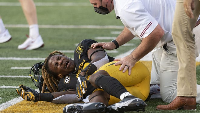 Missouri defensive back Jarvis Ware grimaces on the field after an injury during a game against Alabama last Saturday at Faurot Field.