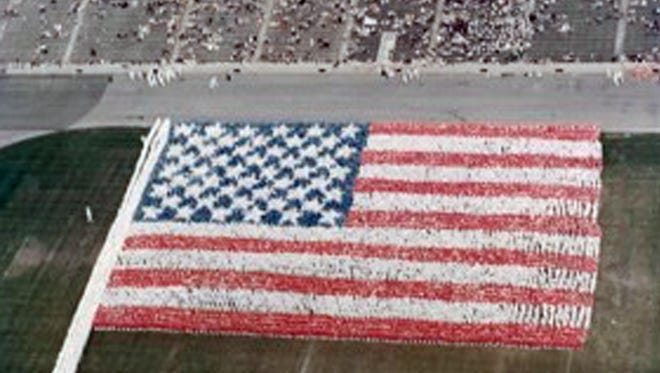 """A """"living flag"""" ceremony in Soldier's Field, Chicago, in 1967."""