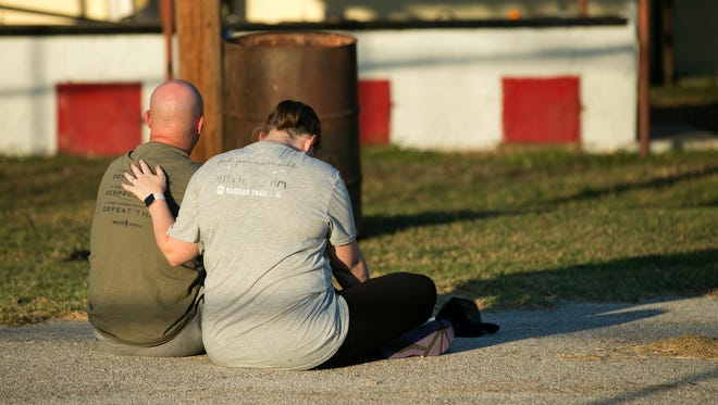 A couple comfort each other at a community center in Sutherland Springs, Texas, near the scene of a mass shooting at the First Baptist Church on Nov. 5, 2017.