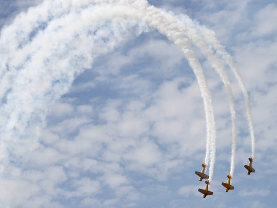 The Canadian Harvard Aerobatic squad, a four-member team flying   monoplanes built in 1941, entertain the crowd in 2015.