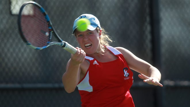 City High's Eve Small returns a shot during her match against West High's Megan Jans at the Hawkeye Tennis and Recreation Complex on Tuesday, April 28, 2015.   David Scrivner / Iowa City Press-Citizen