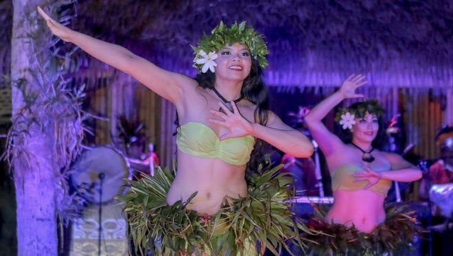 Kim Sablan of the Mana Hune Dance group performs at Fish Eye Marine Park on Aug. 19.