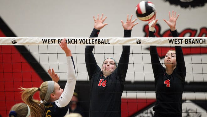 West Branch's Janae Murry, left, and Allyson Simpson go for a block during the Bears' regional quarterfinal match against Regina in West Branch Tuesday, Oct. 27, 2015.