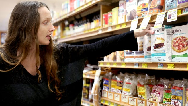 Jazzminh Moore, of Salem, shops for non-GMO foods at LifeSource Natural Foods in Salem.