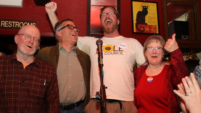 Iowa City Council candidates Jim Throgmorton, from left, John Thomas, Rockne Cole and Pauline Taylor celebrate during a Core Four watch party at Sanctuary on Tuesday, Nov. 3, 2015.