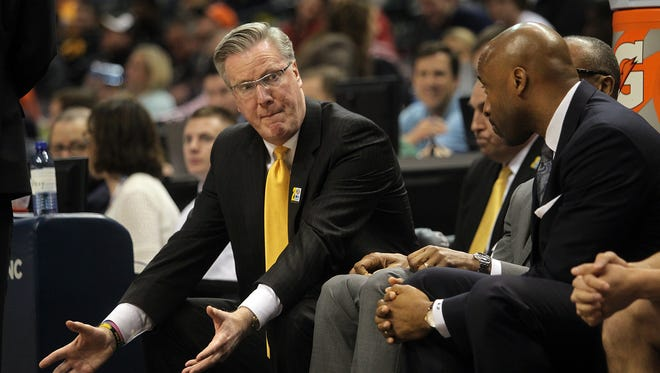 Iowa coach Fran McCaffery, left, along with assistant Andrew Francis will both take trips down memory lane during the NCAA Tournament this week. McCaffery is a Philadelphia native and will face Philly-based Temple on Friday, while Francis is a Brooklyn native returning to coach in his hometown.
