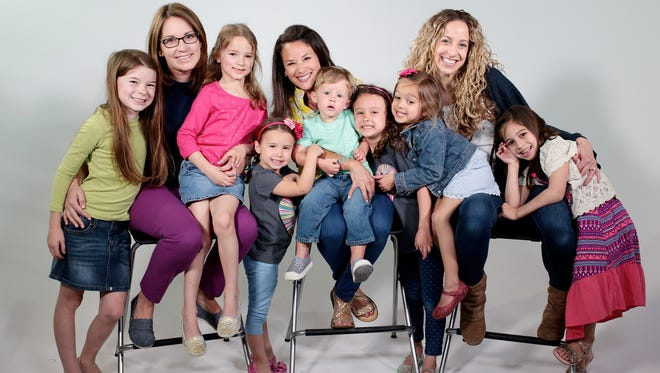 From left: Tess O'Donnell, 9; Kelly O'Donnell, 37; Kate O'Donnell, 6; Leah Dismondy, 4; Maria Dismondy, 37, with Dexter Dismondy, 2, on her lap; Ruby Dismondy, 7; Mila Dorogi, 4, Carly Dorogi, 37, and Avery Dorogi, 6 1/2. Photographed Saturday, April 23, 2016 in Detroit, MI.