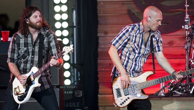 Guitarist James Young, left, and bassist Jon Jones perform with the Eli Young Band on Thursday, June 13, 2013, at Klipsch Music Center in Nobleville, Ind.