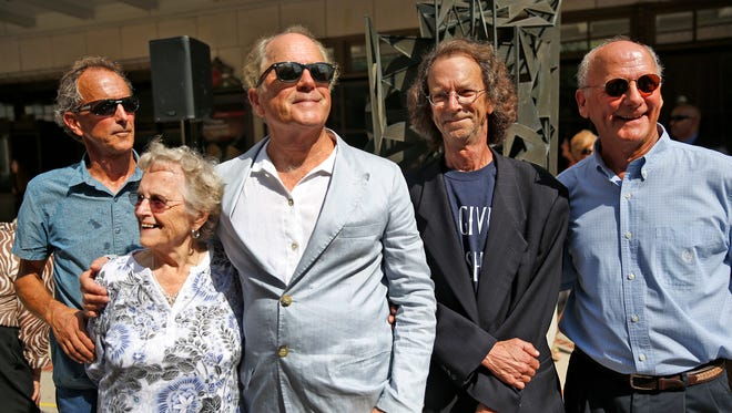 Mark Gummer, left, shown with family members in 2016.