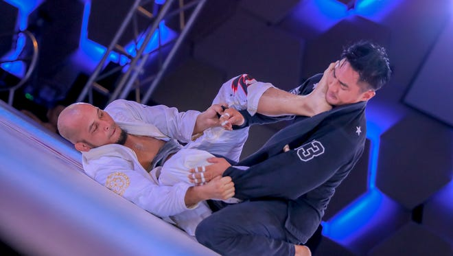 In this file photo, Terrance Aflague (white gi) and Hayato Atalig compete at the Sumbit II grappling event held at Dusit Thani Resort Guam on Sept 3, 2016. PDN file photo
