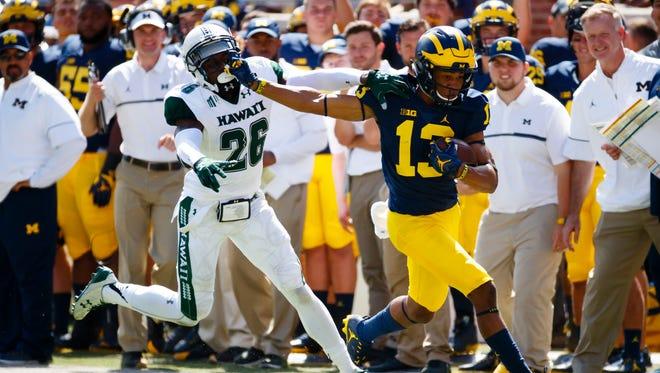 Michigan wide receiver Eddie McDoom (13) runs the ball against Hawaii on Sept. 3, 2016, in Ann Arbor.