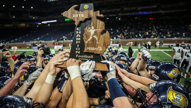 Pewamo-Westphalia's players celebrate winning the title during Division 7 High School Championship game against Detroit Loyola on Saturday November 26, 2016, at Ford Field in Detroit, MI.
