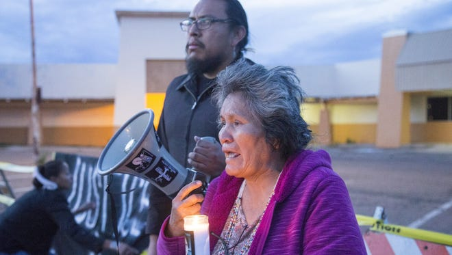 Loreal Tsingine's grandmother, Sarah Morris, 68, speaks during a vigil.