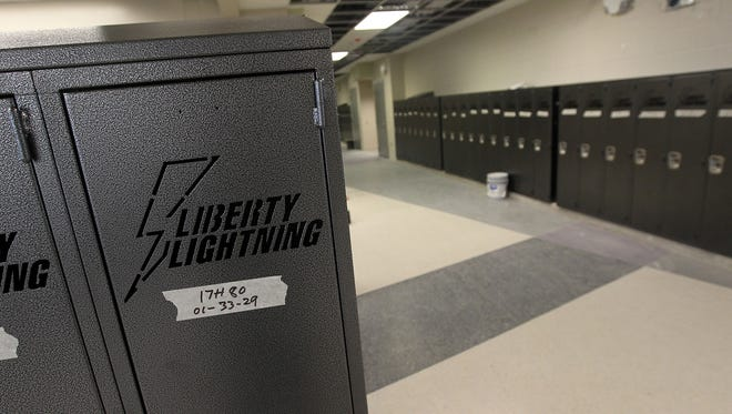 Engraved lockers line the halls of Liberty High on Thursday, March 23, 2017.