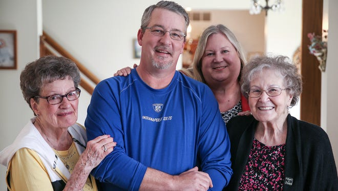 From left, Mary Kay Becher, Chris Becher, Marcie Keithley and Mary Michael pose for a picture in Mary Kay Becher's Indianapolis home, Saturday, April 1, 2017. At a young age, Mary's daughter Judy Keithley surrendered Chris, who was adopted by Mary Kay and Paul Becher. Ever since, Mary wondered about her grandson's well-being. With the help of her daughter Marcie, the two were able to connect with Chris and his family 50 years after Mary saw him last.