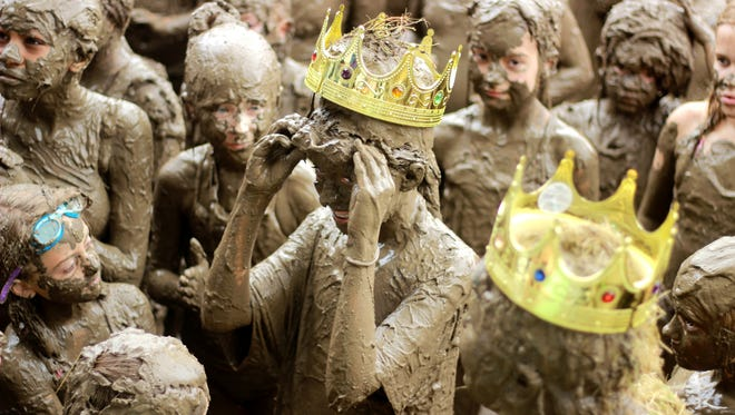 12 year-old, Mackenna Kofahl, of Milan, smiles after being crowned Mud Queen on Tuesday, July 11, 2017, in Westland during Mud Day.