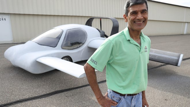Sanjay Dhall with his prototype Flying Car  Thursday, July 20, 2017 at Canton-Plymouth Mettetal Airport in Canton, MI.