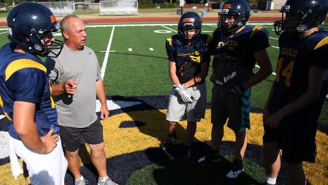 Randy Nyquist, head football coach for Stayton High School, leads a practice before the season starts on Thursday, Aug. 24, 2017.