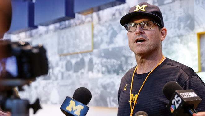 Jim Harbaugh speaks with media during a press conference in Ann Arbor, Aug. 11.