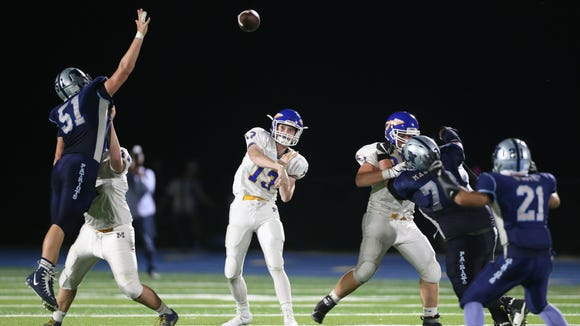 Mahopac quarterback Anthony Lulgjurnj (13) fires a pass during their 14-10 to John Jay in football action at John Jay High School in Hopewell Junction on Friday, September 22, 2017.