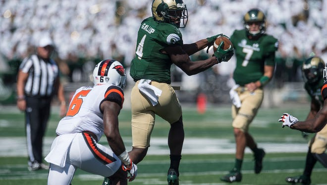 CSU receiver Michael Gallup catches a pass in an Aug. 26 win over Oregon State while quarterback Nick Stevens looks on. Stevens and Gallup are putting up numbers through five games this season that are similar to what Garrett Grayson and Rashard Higgins did with the Rams during a record-breaking run in 2014.