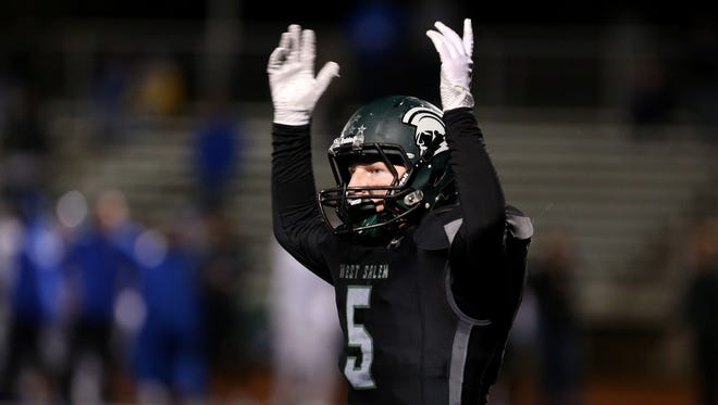 West Salem's Jacob Denning (5) tries to amp up the crowd in the Grant vs. West Salem football game in the second round of the OSAA Class 6A playoffs at West Salem High School on Friday, Nov. 10, 2017. West Salem won the game 33-24.