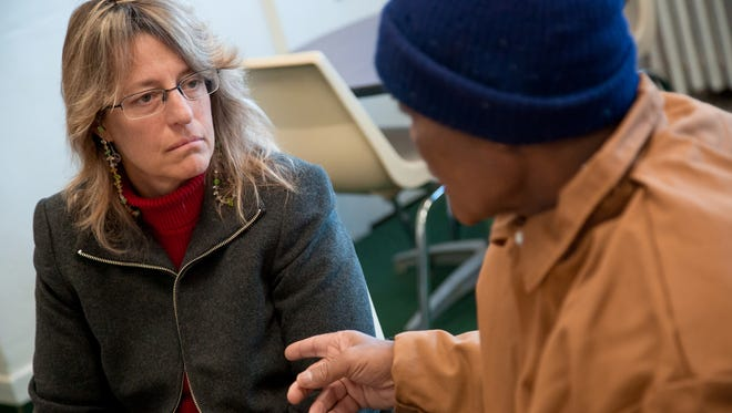 Attorney Valerie Newman, then with the Michigan State Appellate Defender Office, talks with client John Sam Hall on Feb. 2 as he was released from prison after serving 50 years for murder. Hall was among so-called juvenile lifers who were granted resentencing for crimes they committed as juveniles.