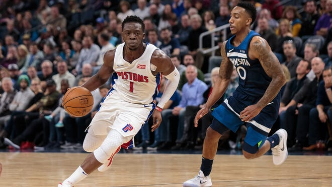 Pistons guard Reggie Jackson (1) dribbles in the second quarter against Timberwolves guard Jeff Teague (0) on Sunday, Nov. 19, 2017, in Minneapolis.