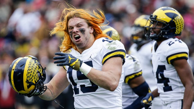 Michigan Wolverines defensive end Chase Winovich celebrates a tackle against South Carolina during the first half of the Outback Bowl at Raymond James Stadium in Tampa, Fla., Monday, Jan. 1, 2018.
