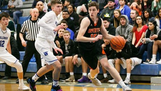 Silverton's Cade Roth (15) drives towards the basket