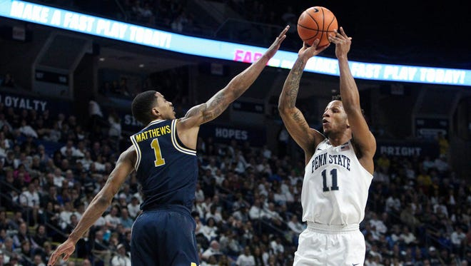 Feb 21, 2018; University Park, PA, USA; Penn State forward Lamar Stevens shoots the ball as Michigan guard Charles Matthews defends during the first half at Bryce Jordan Center.