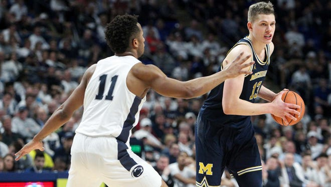 Michigan Wolverines forward Moritz Wagner (13) holds the ball as Penn State Nittany Lions forward Lamar Stevens (11) defends during the second half at Bryce Jordan Center. Michigan defeated Penn State 72-63 on Wednesday, Feb. 21, 2018.