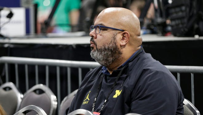 Michigan athletic director Warde Manuel observes John Beilein's press conference at the Alamodome in San Antonio, Texas, Friday, March 30, 2018.