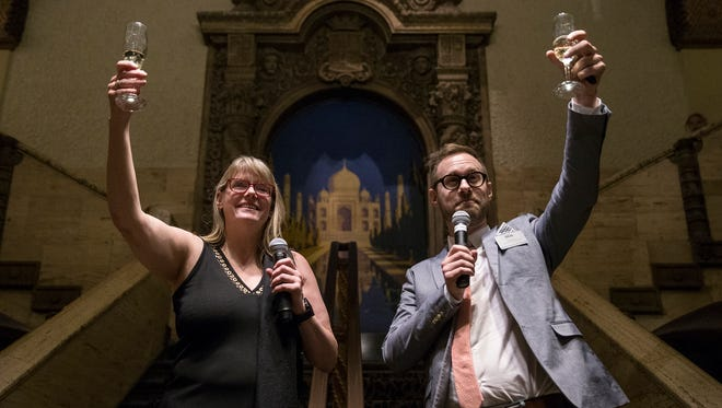 "Managing director Suzanne Sweeney and associate artistic director Benjamin Hanna propose a champagne toast to the crowd as opening night of ""Noises Off"" concludes, Friday, April 27, 2018. The production runs through May 20 at the Indiana Repertory Theatre."