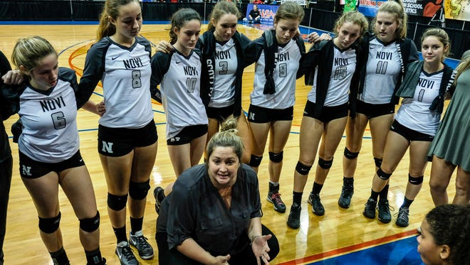 Novi volleyball coach Jen Cottrill won three straight state titles in Class A.
