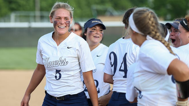 At left, Decatur Central Hawk Karli Ricketts (5) celebrates with teammates after defeating the Roncalli Rebels for the sectional title, 8-3, at Pike High School in Indianapolis, Tuesday, May 22, 2018.