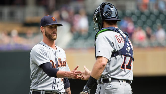 Tigers reliever Shane Greene and catcher Grayson Greiner celebrate the 4-1 win over the Twins on Wednesday.