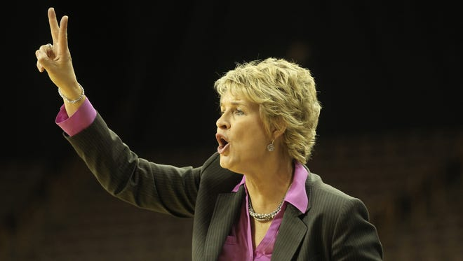 Iowa head coach Lisa Bluder calls a play during the Hawkeyes' game against Minnesota at Carver-Hawkeye Arena on Wednesday, Jan. 8, 2013.