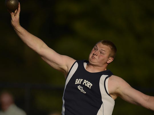 Bay Port's Cole Van Lanen makes a throw in the Division 1 shot put during the WIAA state track and field meet.