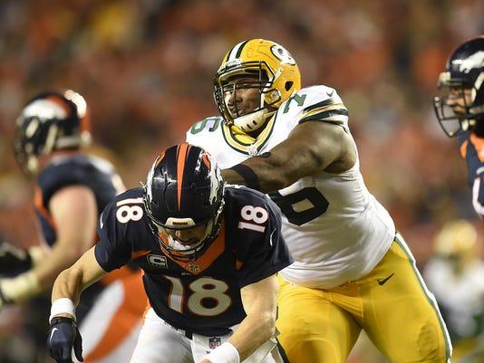 Mike Daniels, Peyton Manning