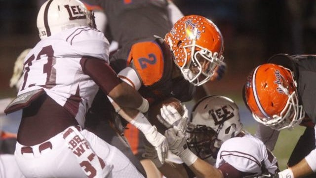 Former Central quarterback Braden Hucks fights for yardage against Midland Lee in a 49-21 win in 2014.