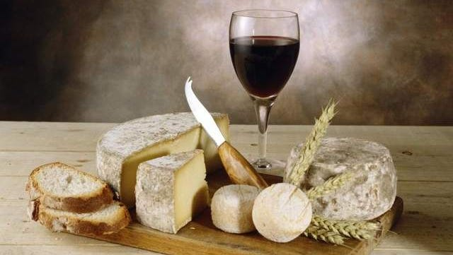 Cheese platter with red wine.