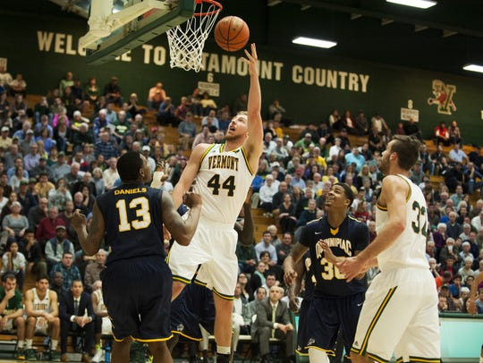 Catamounts forward Nate Rohrer (44) leaps to take a