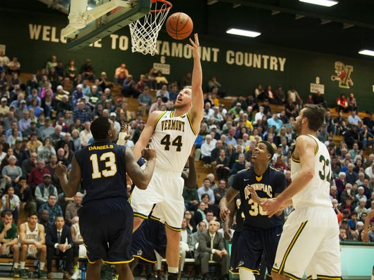 Catamounts forward Nate Rohrer (44) leaps to take a shot during the men's basketball game between the Quinnipiac Bobcats and the Vermont Catamounts at Patrick Gym on Wednesday night.
