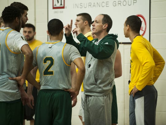 UVM men's basketball head coach John Becker talks to his team during practice at Patrick Gym on Wednesday afternoon.