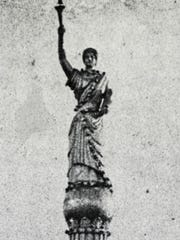 An enlarged photo of a statue on top of the Gottfried