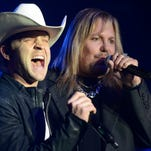 Vince Neil of Motley Crue and Justin Moore performed together in February at Big Machine's CRS party at Marathon Music Works in Nashville.