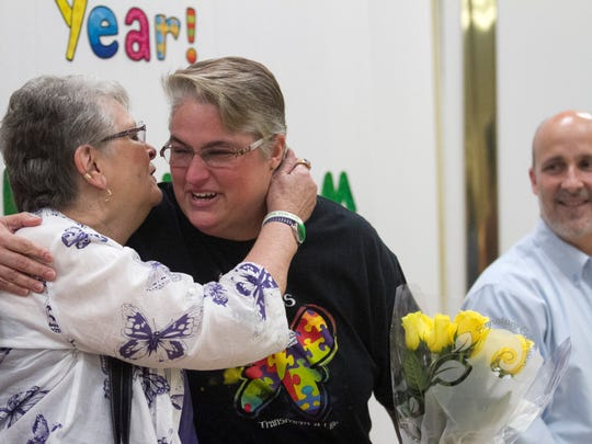 Pat Lochner, left, congratulates Dori Dunham for winning the ESE Teacher of the Year on Friday at the Buckingham Exceptional Student Center.