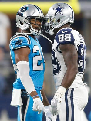 Carolina Panthers cornerback Josh Norman (24) talks with Dallas Cowboys wide receiver Dez Bryant (88) after an interception during the first quarter of a NFL game on Thanksgiving at AT&T Stadium.